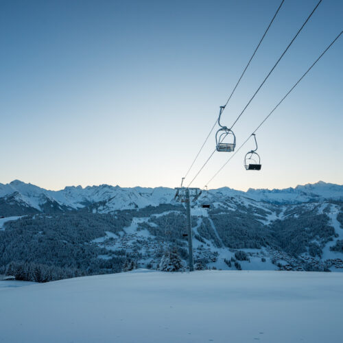 Mountain landscape in winter with ski lifts