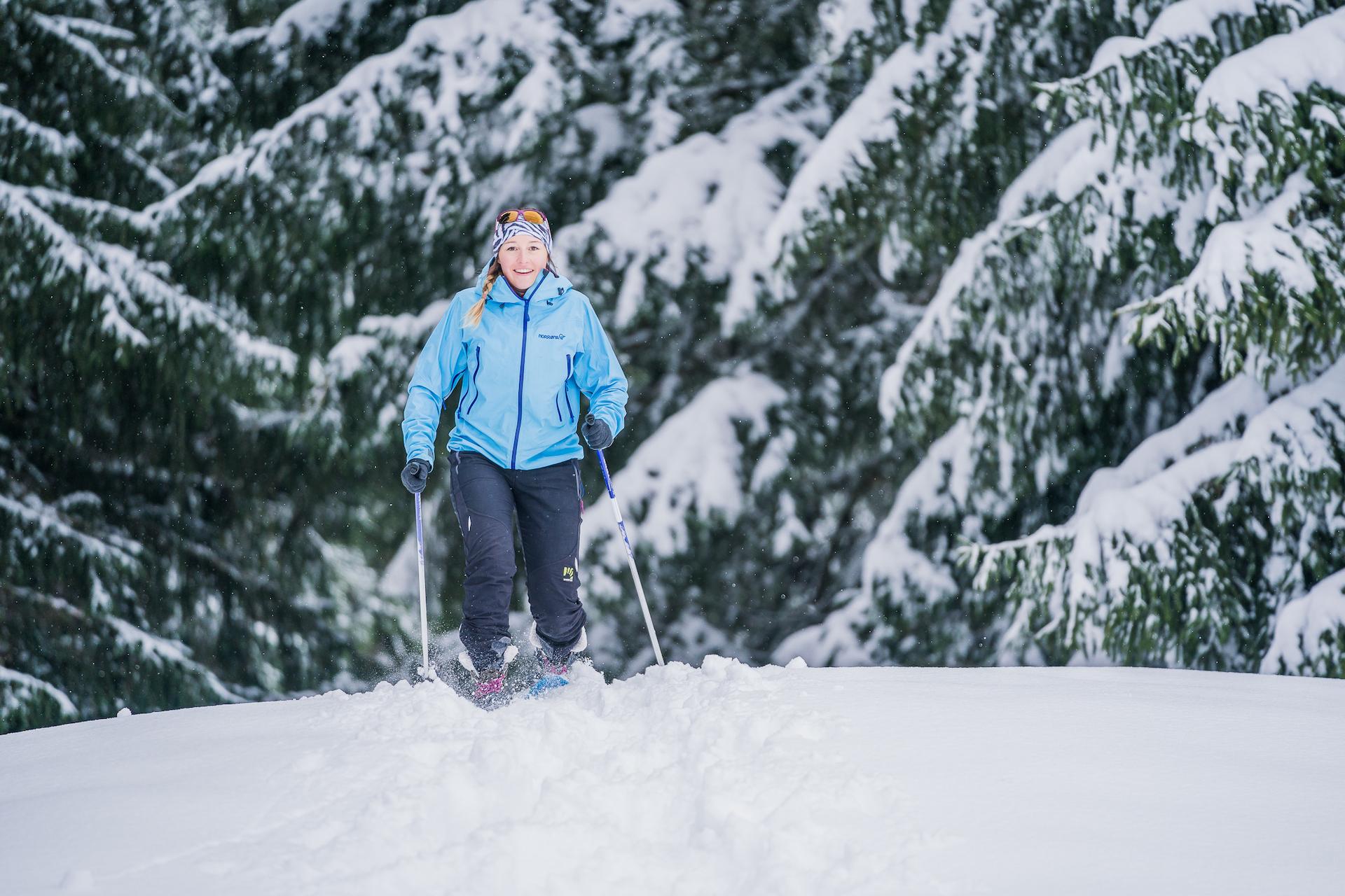 Woman taking a snowshoe hike in winter